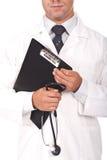 De boeken van de de holdingsnota van de arts en stetoscope Royalty-vrije Stock Foto's