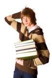 De boeken van de jonge mensenholding Stock Afbeeldingen