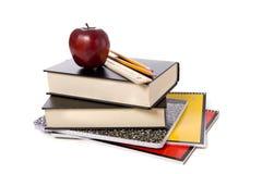 De Boeken van de school met Appel Royalty-vrije Stock Afbeeldingen