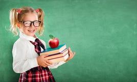 De Boeken van weinig Schoolmeisjeholding stock afbeeldingen