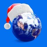 De bol van de aarde en santahoed Stock Foto