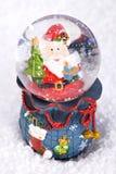 De bol van de Kerstmissneeuw met Santa Claus Stock Foto