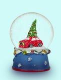 De bol van de Kerstmissneeuw op lichtblauwe achtergrond Kan als a worden gebruikt royalty-vrije stock foto's