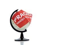 De bol van de wereld met breekbare sticker en exemplaarruimte Stock Foto