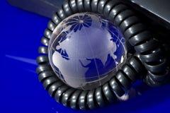 De bol van het glas met telefoon Stock Foto's