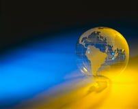 De bol van Plexiglas met blauwe en gele achtergrond Royalty-vrije Stock Afbeelding