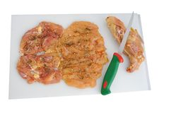 De-boned chicken with knife. On cutting board Stock Photos