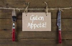 De Boneetlust of geniet van uw maaltijd in duitstalig reclame Stock Foto's