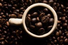 De bonen en de kop van Coffe Royalty-vrije Stock Fotografie