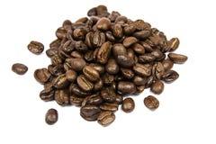 De bonen van Coffe die op wit worden geïsoleerda Royalty-vrije Stock Foto's