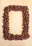De bonen van de koffie als frame met oud document Royalty-vrije Stock Foto's