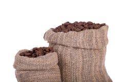 De bonen van de koffie in canvaszak Stock Fotografie
