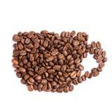 De bonen van de koffie in een vorm van koffiekop stock foto