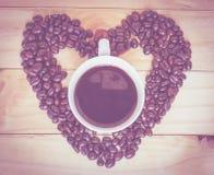 De bonen van de koffie en koffiekop Stock Foto's