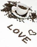 De bonen van de koffie en liefde Stock Foto's