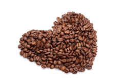 De bonen van de koffie in hartvorm op wit Stock Afbeeldingen
