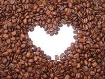 De bonen van de koffie met hart. Stock Afbeelding