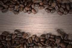 De Bonen van de koffie op hout Royalty-vrije Stock Fotografie