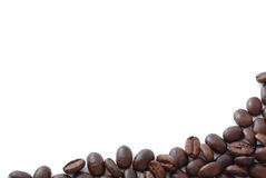 De bonen van de koffie op wit met exemplaar hierboven ruimte Stock Foto
