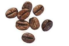 De bonen van de koffie op witte achtergrond royalty-vrije stock afbeeldingen