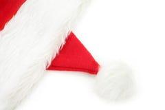 De bont rode hoed van de kerstman stock afbeelding