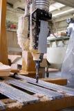 De boor van het metaal in plastic huisvuil Stock Foto