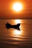De boot en de zon royalty-vrije stock fotografie