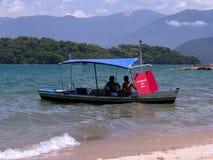 De boot van de verkoper op het strand Stock Fotografie