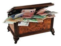 De borst van de schat met geld Royalty-vrije Stock Foto's