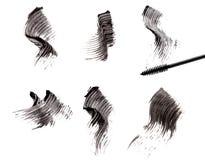 De borstel en de slagen van de mascara royalty-vrije stock foto's