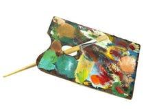 De borstel en het palet van de verf stock afbeeldingen