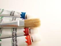 De borstel en painture van de verf royalty-vrije stock afbeelding