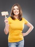 De borstel van de vrouwenholding Stock Fotografie