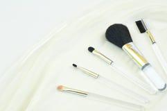 De borstels van de make-up en blozen Stock Foto