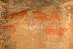 De Bosjesmannen schommelen het schilderen stock foto