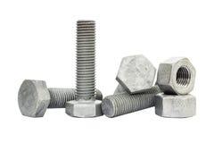 De bout, de nagel en de noot isoleren op witte achtergrond Bout en de noot van ijzer wordt de gemaakt met zink dat met een laag w royalty-vrije stock afbeelding