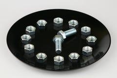 De bouten en de noten symboliseren een wijzerplaat Royalty-vrije Stock Fotografie