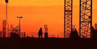 De bouw bij Zonsondergang Stock Foto's