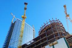 De bouw met kranen royalty-vrije stock afbeelding