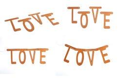 De bouw van het liefdewoord met brievenblokken stock afbeelding