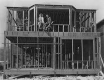 De bouw van hun droomhuis Stock Afbeeldingen