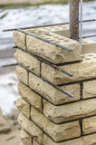 De bouw van kolom van baksteen Royalty-vrije Stock Afbeeldingen
