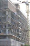 De bouwarbeiders van de veiligheidssystemenverdieping Stock Foto's