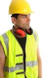 De bouwer die van de timmerman uw bericht bekijkt stock foto