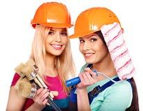 De bouwer van groepsmensen met bouwhulpmiddelen. Stock Foto
