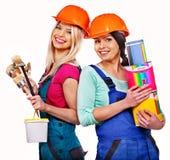 De bouwer van groepsmensen met bouwhulpmiddelen. Stock Afbeeldingen