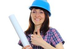 De bouwersvrouw in blauwhelm het tonen beduimelt omhoog royalty-vrije stock afbeelding