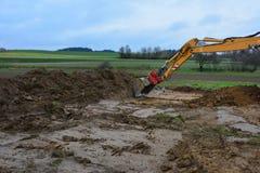 De bouwstichting van de vuilbulldozer Stock Foto