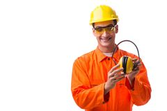 De bouwvakker die met lawaai oortelefoons annuleren stock afbeeldingen