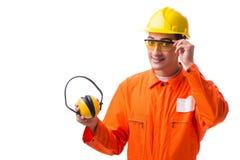 De bouwvakker die met lawaai oortelefoons annuleren stock foto